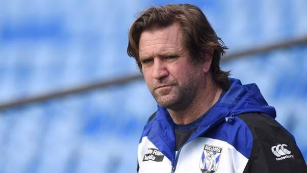 Why is Des Hasler Under Pressure?