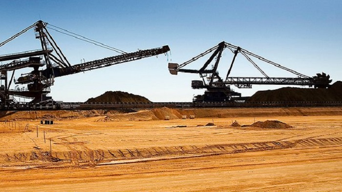 Fortescue Metals battered by poor weather and falling iron ore prices