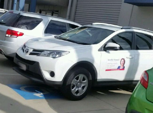 Article image for QLD MP for Ipswich advertising in disabled parking spot