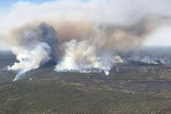 Article image for Firefighters battle to contain 30 fires across the state