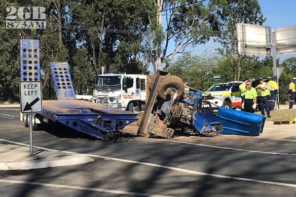 Article image for Excavator comes off the back of a truck at Windsor