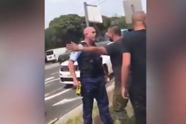 Article image for WATCH | Police officer deals with group of bikies at Mick Hawi's funeral
