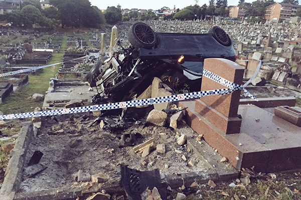 Article image for Alleged drunk driver plows Mercedes through cemetery
