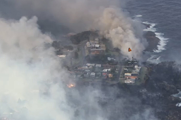 More than 70 homes destroyed in devastating south coast bushfire