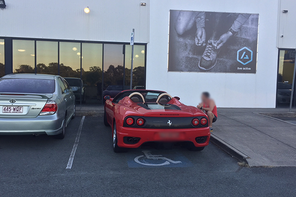 Article image for Ferrari parked in designated disabled parking spot used by elderly gym users