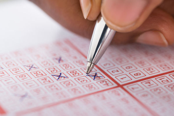 Article image for Dual lotto winner earns a cool $2.4 million. But how will he spend it?