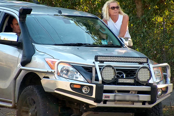 Article image for WATCH   Woman hanging off the side of moving 4WD