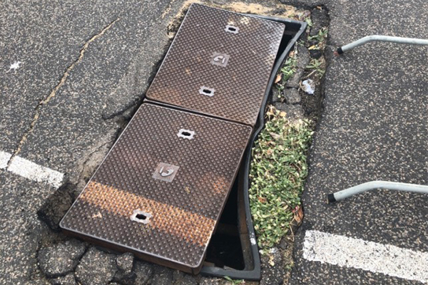 Article image for Telstra pit creating havoc for shop front owners