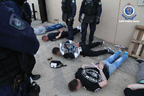 Article image for Extraordinary footage shows police restraining outlaw gang members