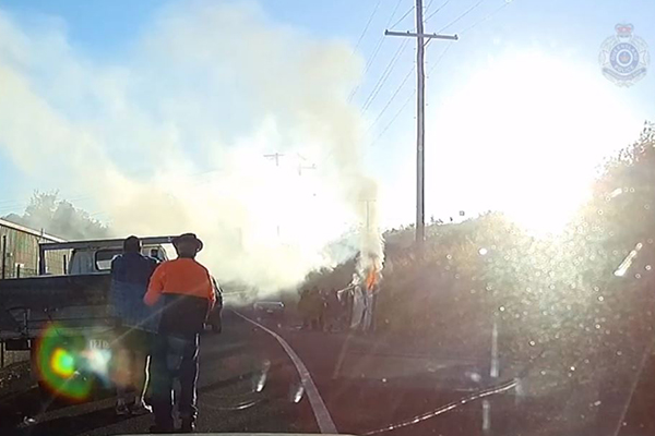 Article image for WATCH | Heroic cops pull man from burning car