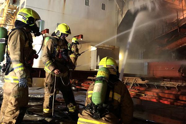 100 firefighters battling ship blaze