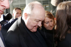 'We get life, he gets home detention': Victims slam sentence for Archbishop who protected paedophile priest