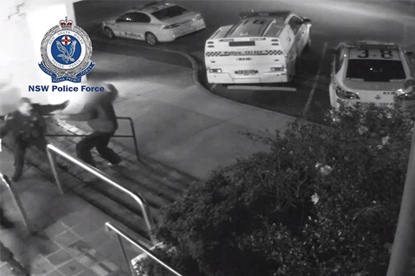 Article image for Shocking CCTV footage shows man allegedly attacking police with a knife