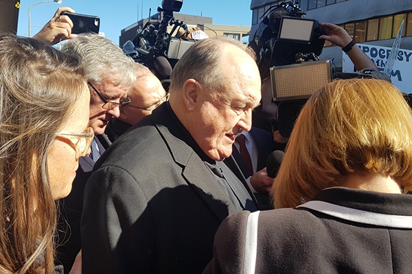Article image for Archbishop gets home detention for protecting paedophile priest