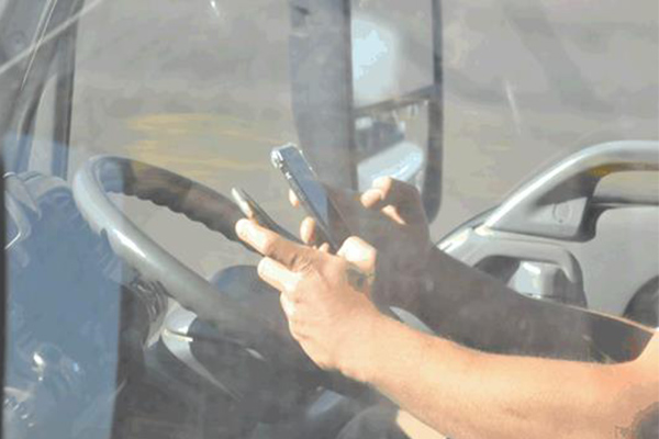 Article image for GALLERY | Drivers snapped using their phones behind the wheel