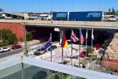 Truck crash sees cars showered in debris