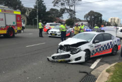 A woman is fighting for her life after her car collided with a police car