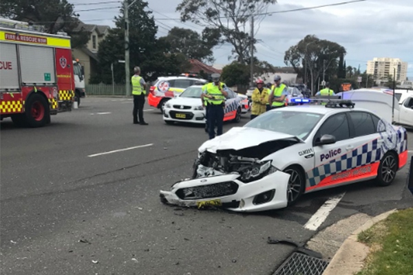 Article image for A woman is fighting for her life after her car collided with a police car