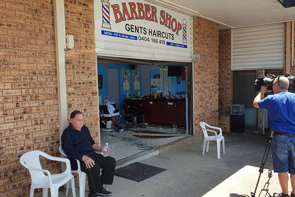 Elderly driver smashes through barber shop in Sydney's west