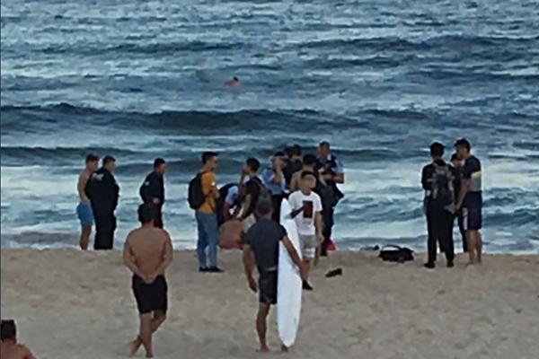 Three men at the beach