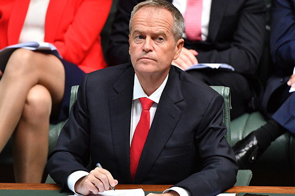Labor's budget reply promises bigger tax cuts