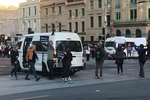 Dozens arrested as vegan activists' cause chaos across Australia