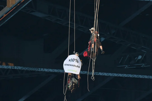 Article image for Climate activists abseil from the Sydney Harbour Bridge