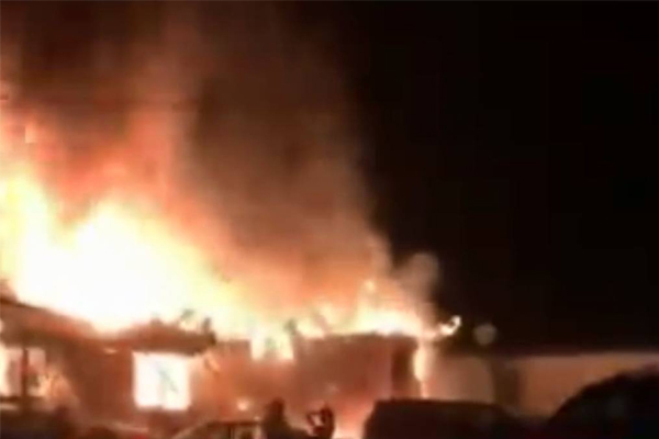 Three children confirmed dead after family trapped in burning home