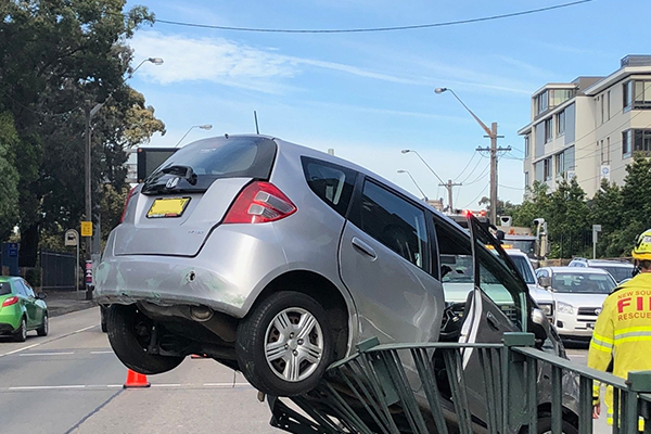Article image for Car crashes into fence on Sydney highway