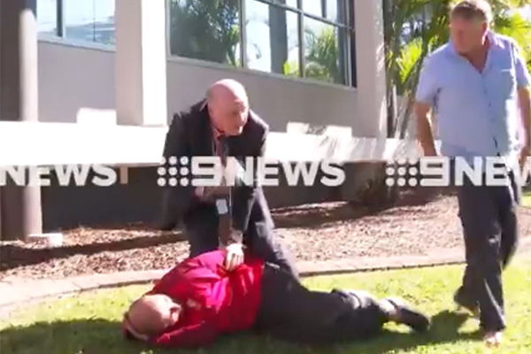 Article image for WATCH | Cop expertly tackles man who interrupted his press conference