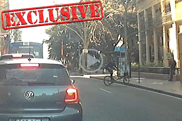 CHARGED | Footage of cyclist's vile attack on anti-abortion protester