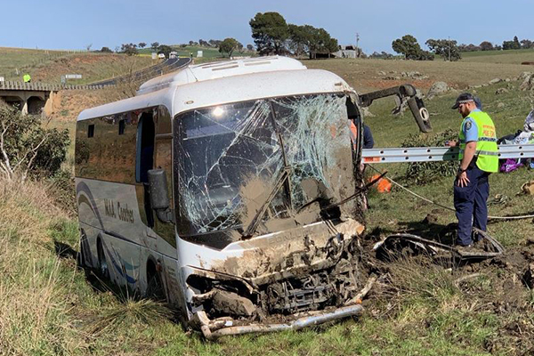 Article image for Nearly 30 injured after bus crashes down embankment