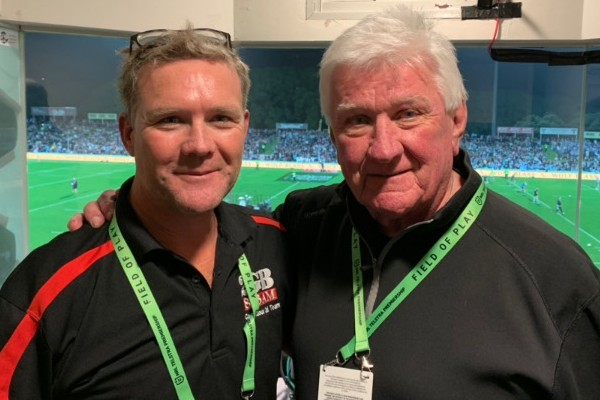 Ray Warren's 'proud moment' going head-to-head with son Chris