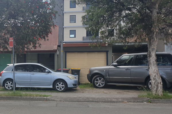 Article image for Travellers ditching their cars for months on suburban street near Sydney Airport