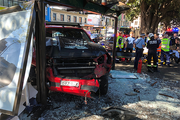 Ute smashes through bus shelter, injuring three
