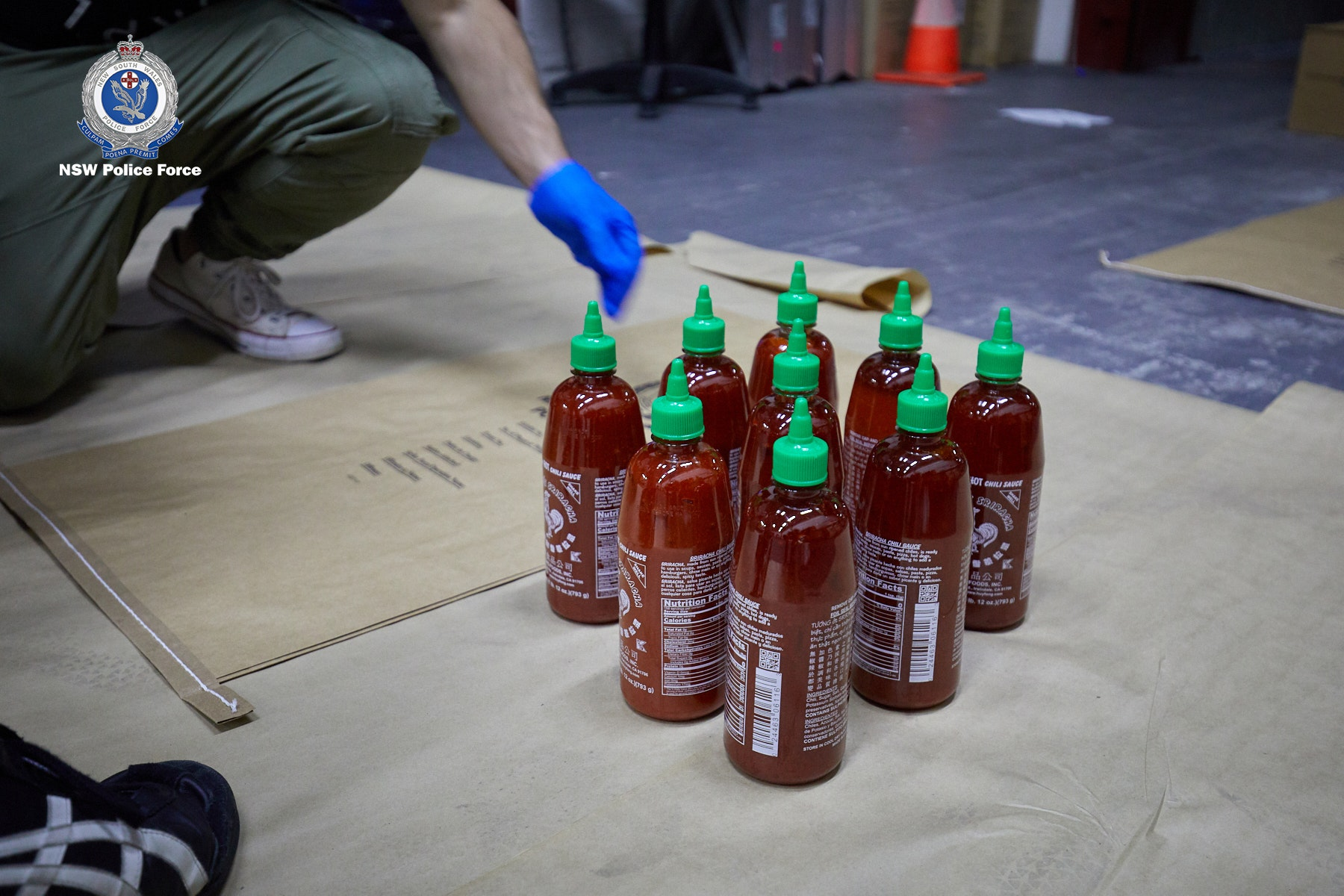 Article image for $300 million worth of ice gives shipment of sriracha sauce an extra kick