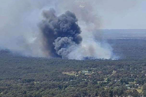 Bushfire burns out of control in Sydney's north-west