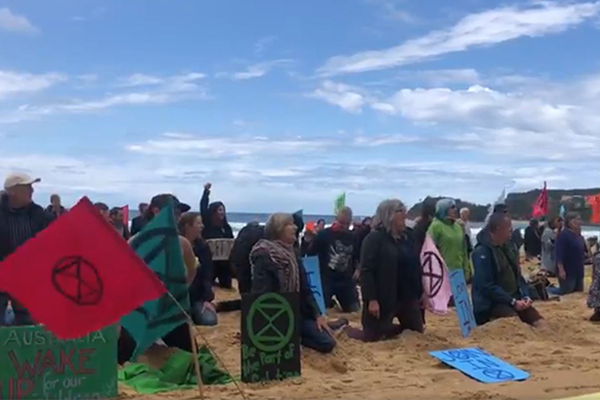 Article image for WATCH | Climate protesters perform their most creative stunt yet