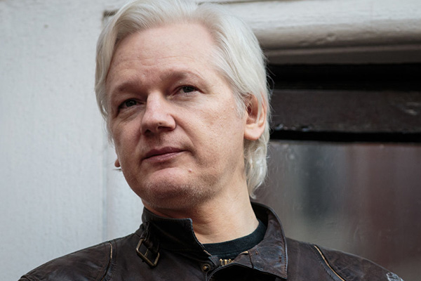 Australia slammed for 'piss-weak' treatment of Julian Assange