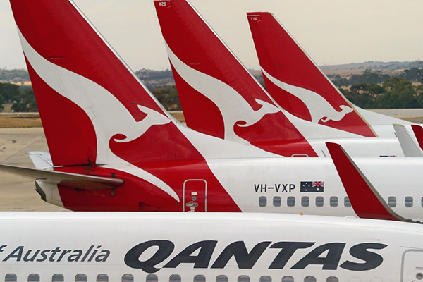 Qantas executive blames flight delays on climate change