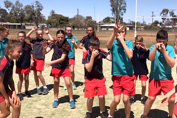 Article image for Young Aussies in drought-ravaged town call for nationwide rain dance