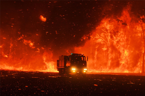 Article image for Bushfires burn across the state as firefighters battle emergency level blazes