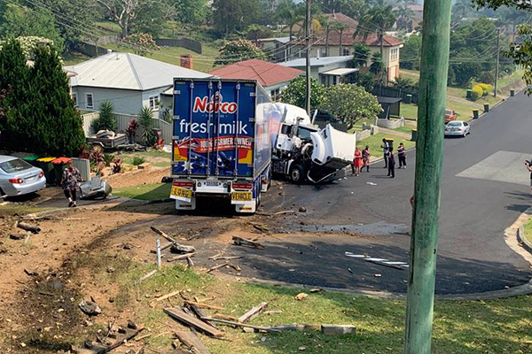 Article image for Delivery truck flies off highway and crashes into residential street