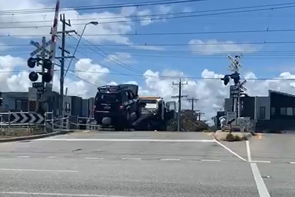 WATCH | Tow truck narrowly avoids being cleaned up by train