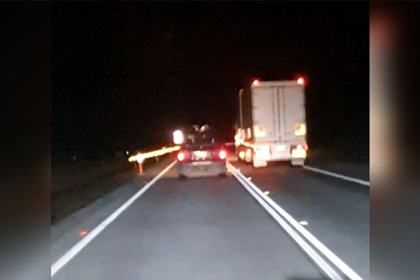Article image for WATCH | Truck caught driving on the wrong side of the Pacific Highway