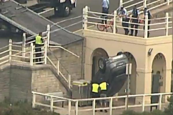 Car crashes over barrier at popular Bondi tourist spot