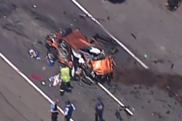 Article image for Woman critical after truck flips onto car in Sydney's south-west