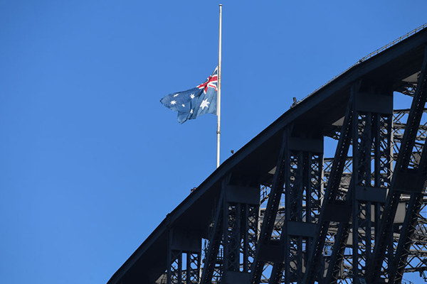 Flags fly at half-mast after three Americans killed fighting fires