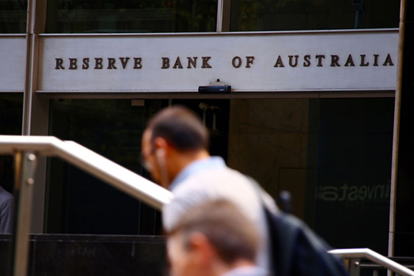 Australia cuts rates to record low as risks mount