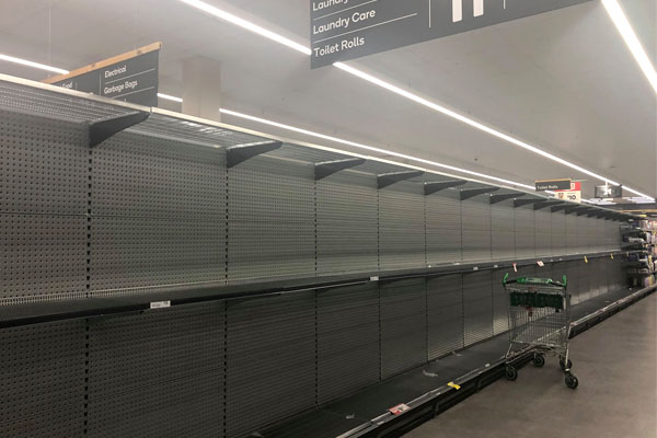 Article image for Supermarkets consider product limits as panic buying empties shelves
